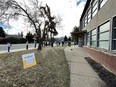 Voters line up to advance vote in the municipal election outside of Bellevue Community League at 7308 112 Ave NW in Edmonton, on Wednesday, Oct. 13, 2021.