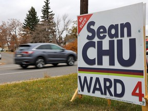 Traffic on 4th Street N.W. passes a Sean Chu campaign sign in Ward 4 on voting day in the municipal election, Monday, October 18, 2021.