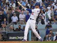 Los Angeles Dodgers first baseman Cody Bellinger hits a three-run home run in the eighth inning of Game 3 of the 2021 NLCS against the Atlanta Braves at Dodger Stadium on Oct. 19, 2021.