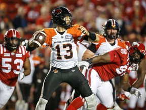 BC Lions quarterback Michael Reilly throws the ball as Calgary Stampeders close in at McMahon Stadium in Calgary on Thursday, Aug. 12, 2021.