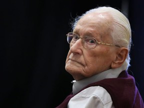 """(FILES) This file photo taken on July 1, 2015 shows defendant and German former SS officer Oskar Groening, dubbed the """"bookkeeper of Auschwitz"""", at court in Lueneburg, northern Germany, ahead of his trial. The former Nazi SS guard, now 96, lost his final legal challenge against his jail sentence, as Germany's highest court rejected his appeal on December 29, 2017."""
