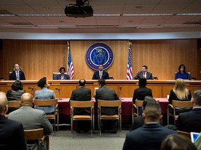 FCC chairman Ajit Pai and commission members take their seats for a hearing at the FCC on Dec. 14, 2017 in Washington, D.C.  (BRENDAN SMIALOWSKI/AFP/Getty Images)