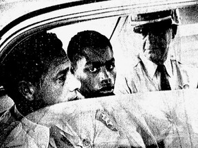 FILE - In this February 1964 file photo, Henry Montgomery, flanked by two deputies, awaits the verdict in his trial for the murder of Deputy Sheriff Charles H. Hurt in Baton Rouge, La. More than a half-century after the Louisiana teen was sent to prison for killing a sheriff's deputy, the now 71-year-old inmate is getting his first chance at freedom since the U.S. Supreme Court ruled in his favor. Louisiana's parole board scheduled a hearing Thursday, Dec. 14, 2017, for Montgomery.