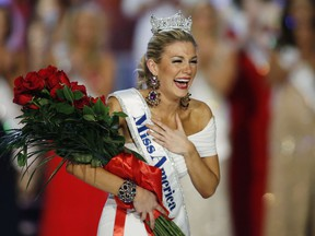 In this Jan. 12, 2013 file photo, Miss New York Mallory Hytes Hagan reacts as she is crowned Miss America 2013 in Las Vegas.  (AP Photo/Isaac Brekken, File)