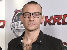 In this Dec. 13, 2014 file photo, Chester Bennington poses in the press room at the 25th annual KROQ Almost Acoustic Christmas in Inglewood, Calif. The Los Angeles County coroner says Bennington, who sold millions of albums with a unique mix of rock, hip-hop and rap, has died in his home near Los Angeles. He was 41. Coroner spokesman Brian Elias says they are investigating Bennington's death as an apparent suicide but no additional details are available.