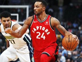Toronto Raptors forward Norman Powell, front, drives past Denver Nuggets guard Jamal Murray in the first half of an NBA basketball game Wednesday, Nov. 1, 2017, in Denver. (AP Photo/David Zalubowski)