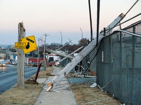 Damaged power lines are seen in Dartmouth, N.S., on Tuesday, Dec. 26, 2017. THE CANADIAN PRESS/Andrew Vaughan