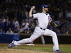 In this Wednesday, Oct. 18, 2017, file photo, Chicago Cubs relief pitcher Wade Davis throws during Game 4 of the National League Championship Series against the Los Angeles Dodgers.