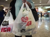 Montreal implemented its long-planned ban on plastic bags on Monday, making it the first major Canadian city to do so. A woman leaves a grocery store in Montreal, Friday, May 15, 2015. THE CANADIAN PRESS/Ryan Remiorz ORG XMIT: CPT102