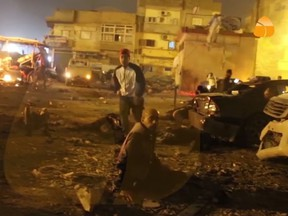 This grab taken from Al-Hadath Channel video on Tuesday Jan. 23, 2018, shows debris at the site of an explosion in Benghazi, Libya. Two consecutive car bombs detonated near a mosque in the Libyan city of Benghazi on Tuesday, killing at least nine people and injuring dozens more.