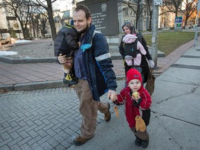 Joshua Boyle, his wife, Caitlan Boyle and their three children, Jonah, Noah and Grace are seen strolling up Elgin St. past the courthouse in downtown Ottawa on Nov. 22, 2017.
