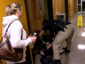 In this screenshot, teacher Deyshia Hargrave is handcuffed outside Vermillion Parish school board meeting on Jan. 8, 2018.