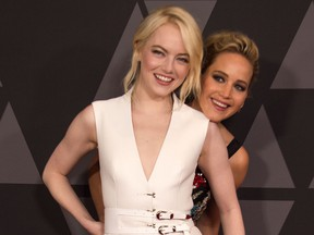 Actresses Emma Stone (L) and Jennifer Lawrence attend the 2017 Governors Awards, on November 11, 2017, in Hollywood, California.    (VALERIE MACON/AFP/Getty Images)