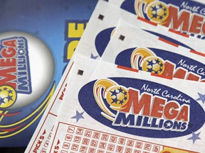 In this July 1, 2016, file photo, Mega Millions lottery tickets rest on a counter at a Pilot travel center near Burlington, N.C.  The jackpot for the Mega Millions lottery game has climbed to over $450 million, just hours before the drawing, Friday, Jan. 5, 2018.