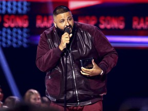 """In this Sunday, Nov. 19, 2017, file photo, DJ Khaled accepts the award for favorite song rap/hip-hop for """"I'm the One"""" at the American Music Awards at the Microsoft Theater in Los Angeles."""