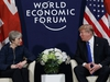 A Thursday, Jan. 25, 2018 file photo of US President Donald Trump meeting with British Prime Minister Theresa May at the World Economic Forum in Davos, Switzerland. President Donald Trump has wished Prince Harry and fiancee Meghan Markle well and says he is not aware of having received an invitation to their royal wedding in May.