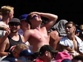 A sunburnt English fan looks to the sun while watching the cricket on the fourth day of the fifth Ashes cricket Test match between Australia and England at the SCG in Sydney on January 7, 2018. (WILLIAM WEST/AFP/Getty Images)