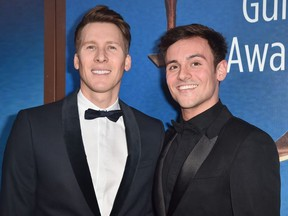 Dustin Lance Black and Tom Daley attends the 2018 Writers Guild Awards L.A. Ceremony at The Beverly Hilton Hotel on February 11, 2018 in Beverly Hills, California.