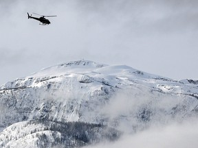 A search and rescue helicopter heads toward a deadly avalanche site in a March 14, 2010 photo near Revelstoke, B.C. An avalanche expert is warning people planning to hit backcountry slopes in eastern British Columbia and western Alberta in the coming days to be extra careful. THE CANADIAN PRESS/Jeff McIntosh
