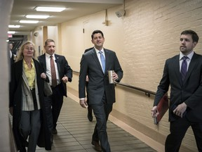 House Speaker Paul Ryan, R-Wis., center, walks to a Republican strategy conference at the Capitol as House GOP leaders are proposing to keep the government open for another six weeks by adding a year's worth of Pentagon funding to a stopgap spending bill, in Washington, Tuesday, Feb. 6, 2018.