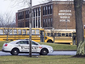 A police car is parked outside Jackson Township Middle School, Tuesday, Feb. 20, 2018 in Massillon, Ohio.