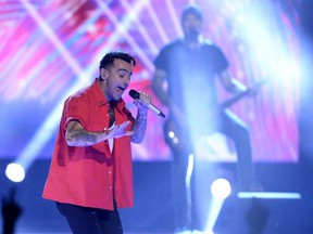 Hedley performs during WE Day Toronto celebrations on Thursday Sept. 28, 2017. Corus Radio says it has temporarily suspended all airplay of Hedley across its music stations as the Canadian rockers face allegations of sexual misconduct.