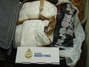 In this photo released by Australia Boarder Force, a suitcase filled with cocaine after it was seized by customs onboard the MS Sea Princess in Sydney, Australia, Sunday, Aug. 28, 2016. (Australian Boarder Force via AP)