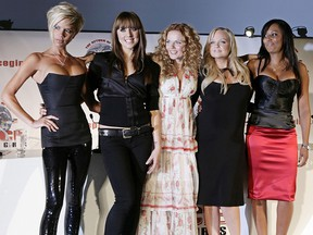Spice Girl members Victoria Beckham, (L) Mel C, (2nd L) Geri Halliwell, (3rd L) Emma Bunton (2nd R) and Mel B (R) pose for photographs before a press conference at the O2 Dome in east London, June 28, 2007. (Leon Neal/AFP/Getty Images)