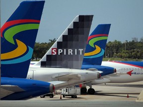Spirit Airlines planes sit on the tarmac at the Fort Lauderdale International Airport in Fort Lauderdale, Fla., on June 14, 2010.