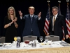 President Donald Trump stands with Rep. Randy Hultgren, R-Ill., right, and his wife Christy Hultgren after arriving for the National Prayer Breakfast, Thursday, Feb. 8, 2018, in Washington. (AP Photo/Evan Vucci) ORG XMIT: DCEV107