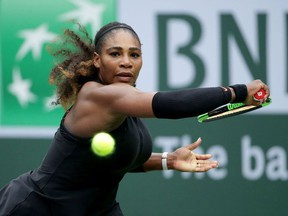 Serena Williams lunges to return a backhand to Kiki Bertens of the Netherlands during the BNP Paribas Open on March 10, 2018 at the Indian Wells Tennis Garden in Indian Wells, California.