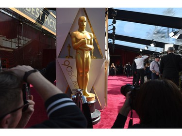 "Photographers and TV crews get ready on the red carpet a few hours before the ""Oscars"", the 90th Annual Academy Awards on March 4, 2018, in Hollywood, California."