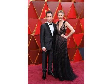 US actor Sam Rockwell (L) and his wife US actress Leslie Bibb arrive for the 90th Annual Academy Awards on March 4, 2018, in Hollywood, California.