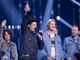 Arcade Fire celebrates their Juno for Album of the Year at the Juno Awards in Vancouver, Sunday, March, 25, 2018.