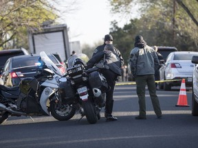Authorities are investigating the scene in East Austin, Texas, after a teenager was killed and a woman was injured in the second Austin package explosion in the past two weeks Monday, March 12, 2018. Authorities say a package that exploded inside of an Austin home on Monday is believed to be linked to a deadly package sent to another home in Texas' capital city earlier this month. (Ricardo B. Brazziell/Austin American-Statesman via AP) ORG XMIT: TXAUS103