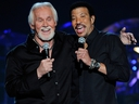 Singer-songwriters Kenny Rogers (L) and Lionel Richie perform during Lionel Richie and Friends in Concert presented by ACM at the MGM Grand Garden Arena April 2, 2012 in Las Vegas, Nevada. (Photo by Ethan Miller/Getty Images)
