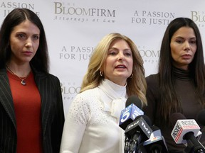 Attorney Lisa Bloom (C) holds a press conference with her clients Faviola Dadis (L) and Regina Simons, who are accusing actor Steven Seagal of sexual assault, at The Bloom Firm on March 19, 2018 in Woodland Hills, California. (Photo by Frederick M. Brown/Getty Images)