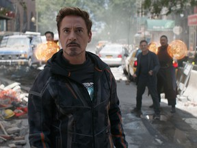 Tony Stark/Iron Man (Robert Downey Jr.) w/ Doctor Strange (Benedict Cumberbatch), Bruce Banner (Mark Ruffalo) and Wong (Benedict Wong) in the background L to R. Photo: Film Frame.