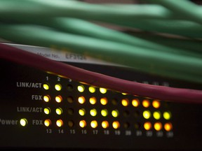 Lights on an internet switch are lit up in an office in Ottawa, on Feb. 10, 2011. Two of Canada's biggest internet service providers are preparing to increase their subscriber prices.
