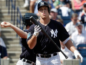 New York Yankees' Aaron Judge reacts after he struck out swinging during the first inning of a baseball spring exhibition game against the Detroit Tigers on Feb. 28, 2018