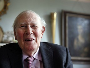 In this photo taken Monday, April 28, 2014, Roger Bannister, who as a young man was the first person to break the 4-minute barrier for the mile run in 1954, poses during an interview with The Associated Press at his home in Oxford, England.