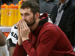 In this Jan. 8, 2018, file photo, Cleveland Cavaliers' Kevin Love watches from the bench in the second half of an NBA basketball game against the Minnesota Timberwolves in Minneapolis