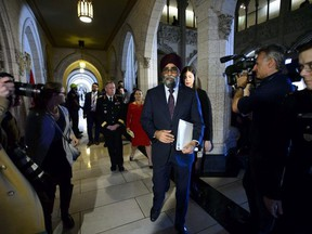 Minister of National Defence Minister Harjit Sajjan, Minister of Foreign Affairs Chrystia Freeland and Chief of Defence Staff Jonathan Vance leave after holding a press conference on Canada's peacekeeping mission to Mali in the foyer of the House of Commons on Parliament Hill in Ottawa Monday, March 19, 2018.