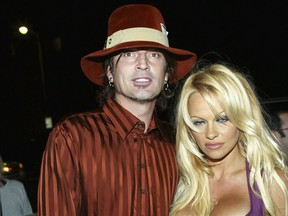 """Tommy Lee and Pamela Anderson attend the film premiere of """"Scary Movie 3"""" at the AMC Theatres Avco Cinema on October 20, 2003 in Westwood, California.   (Frederick M. Brown/Getty Images)"""