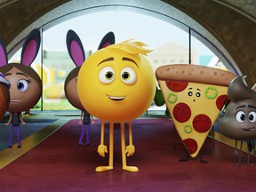 "This file image released by Sony Pictures shows Gene, voiced by T.J. Miller, center, in Columbia Pictures and Sony Pictures Animation's ""The Emoji Movie."""