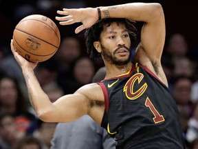 In this Jan. 20, 2018, file photo, Cleveland Cavaliers' Derrick Rose passes during the second half of an NBA basketball game against the against the Oklahoma City Thunder in Cleveland
