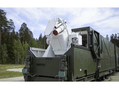 In this video grab provided by RU-RTR Russian television via AP television on Thursday, March 1, 2018, a Russian military truck with a laser weapon mounted on it is shown at an undisclosed location in Russia.