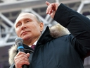 Russian President Vladimir Putin gestures while speaking during a massive rally in his support as a presidential candidate at the Luzhniki stadium in Moscow, Russia, Saturday, March 3, 2018.