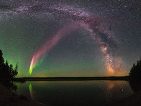 """The celestial phenomenom known as """"Steve"""" and the Milky Way are shown in the sky over Childs Lake, Manitoba in a handout photo."""