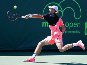 Denis Shapovalov of Canada serves against Damir Dzunhur of Bosnia and Herzegovina during Day 6 of the Miami Open at the Crandon Park Tennis Center on March 24, 2018 in Key Biscayne, Fla.  (Al Bello/Getty Images)